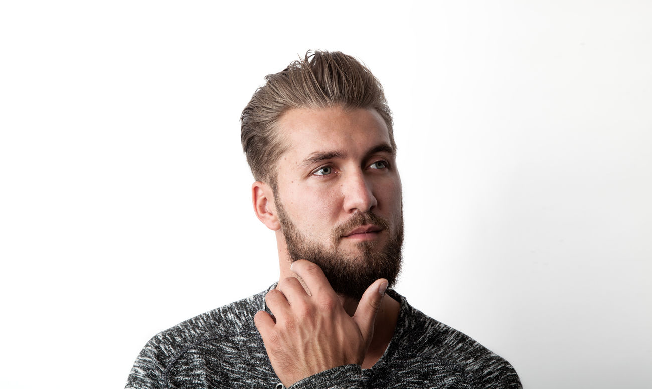 Portrait of handsome young man on white background Attractive Background Beard Bearded Business Caucasian Close Up Confident  Copy Headshot Intelligent Man Manager Muslime One Pensive People Person Place Space Student Studio Shot Successful White Young