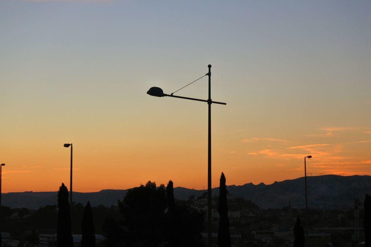 Silhouette Street Light Against Sky During Sunset
