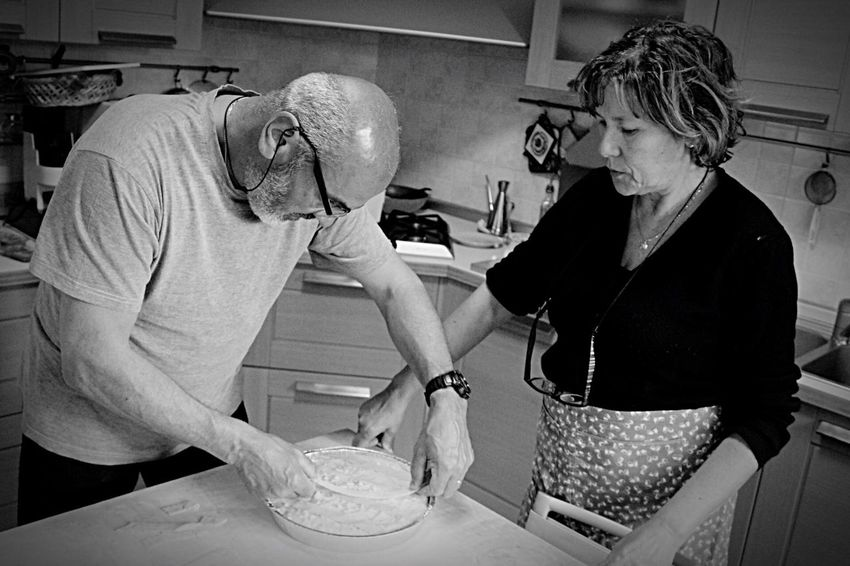 Italian do it better 🍰 Senior Adult Senior Women Senior Men Two People Domestic Kitchen Domestic Life Mature Adult Kitchen Retirement Indoors  Real People Lifestyles Senior Couple Adult Women Food Commercial Kitchen People Mixing Teamwork
