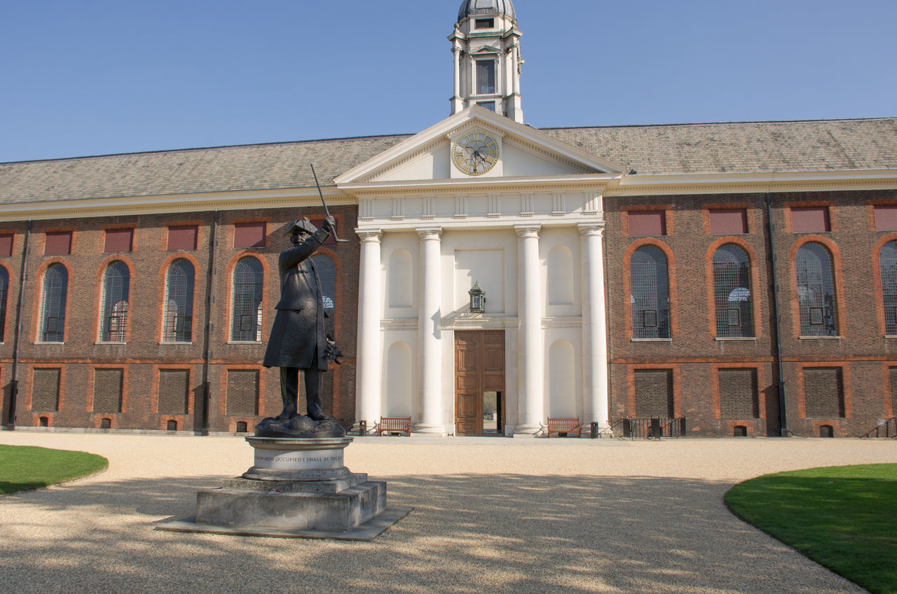 Front of Royal Chelsea Hospital with pensioner statue in foreground Architecture Architecture Building Exterior Built Structure Chelsea Chelsea Hospital Christopher Wren Door Façade Front View Grand Outdoors Statue Veterans War Wren