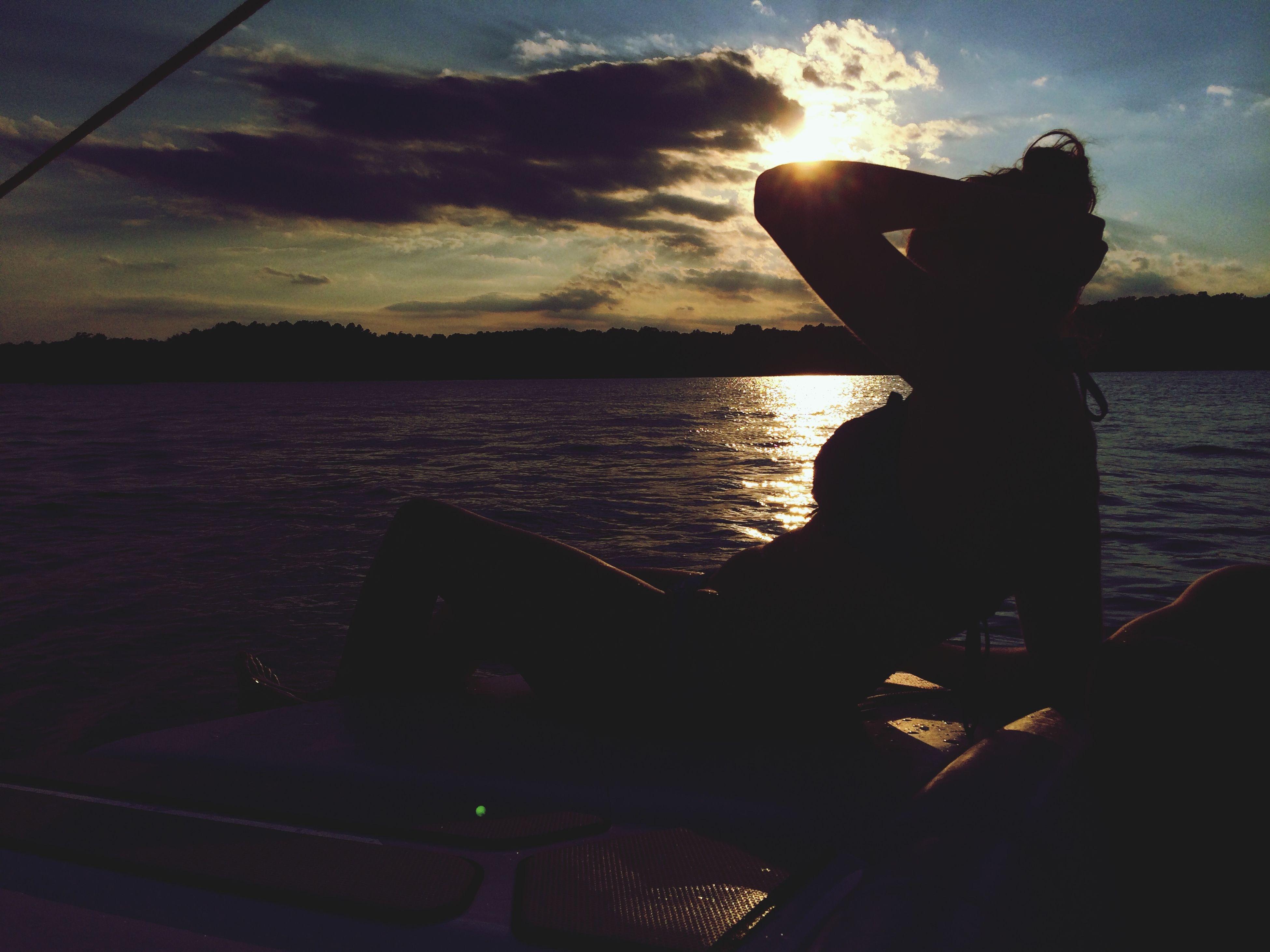 silhouette, water, sky, sunset, cloud - sky, sea, reflection, cloud, sunlight, sun, nature, dusk, standing, men, leisure activity, outdoors, beauty in nature, lifestyles