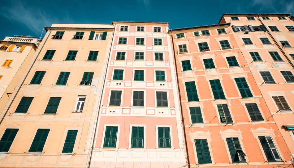 Typical houses in Italian village. Camogli, Genoa. Camogli Camogli Italia City Exterior Houses Italian Riviera Ancient Architecture Architecture Building Exterior Built Structure Day Europe Facade Building Highrise Italian Italy No People Old Architecture Outdoors Residential Building Sky Sunny Day Town Window
