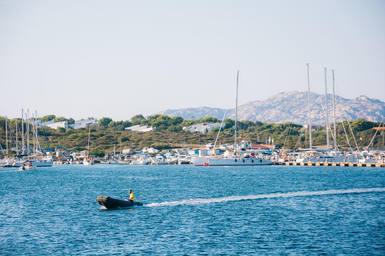 Boat Moving On Lake Against Harbor