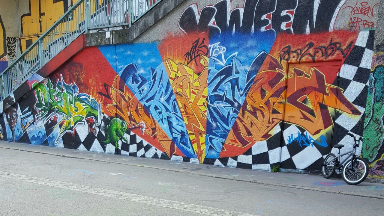 graffiti, art and craft, street art, multi colored, day, street, road, transportation, outdoors, real people, architecture