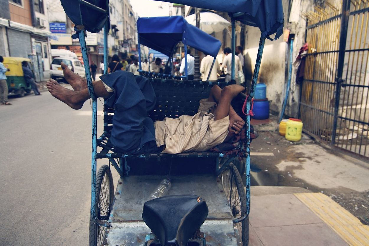 Sleeping on tricycle Street Real People One Person City Tricycle Sleep Rest Duty