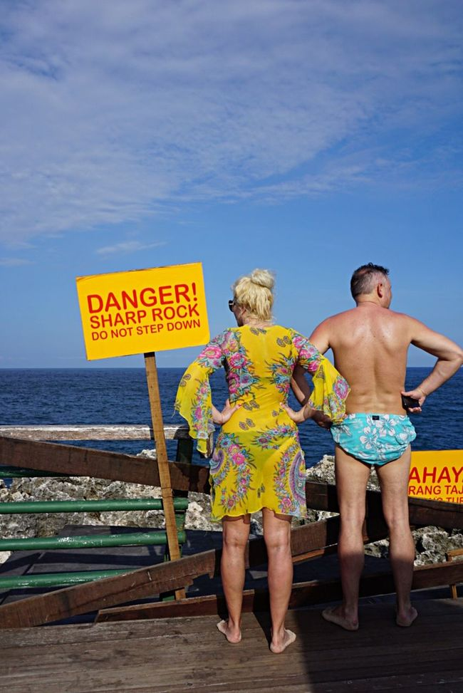 People And Places Couple TakeoverContrast Enjoying The View Thinking Idea Street Photography Sea Middle Age Funny Couple Body Language Bali INDONESIA Tourist In My Town Tourist Sign Yellow Sign Danger Danger Sign Fresh On Eyeem  EyeEm Gallery Showcase July People Together Colour Of Life Two Is Better Than One