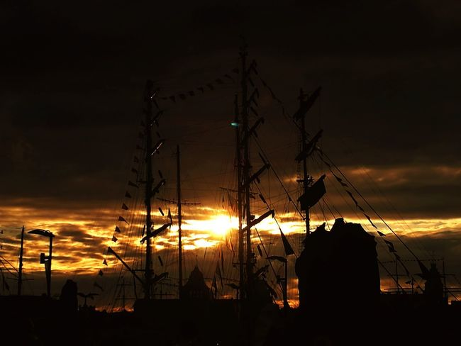 Sunset Silhouette Cloud - Sky Night No People Sky Outdoors Low Angle View Electricity Pylon Nature Golf Club Sail Background River Ship Sailboat Clouds And Sky Cloud Water Tranquility Sea Breathing Space The Week On EyeEm Your Ticket To Europe Mix Yourself A Good Time