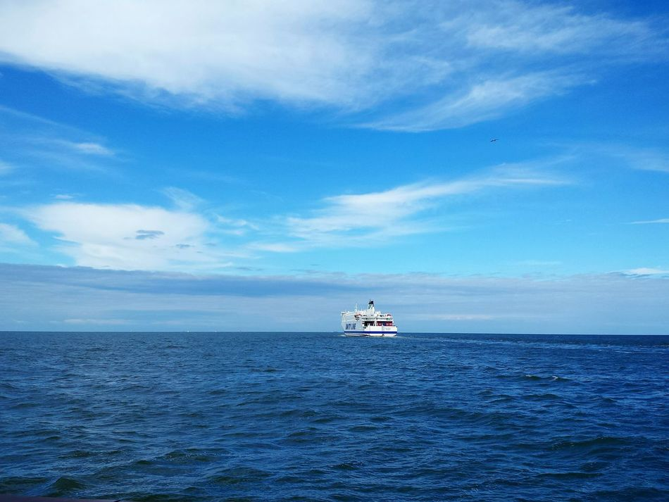 Sea Horizon Over Water Nautical Vessel Cruiseliner on baltic sea Waterfront Sky Blue Ship Scenics Mode Of Transport Tranquility Tranquil Scene Rippled Ocean Beauty In Nature Seascape Sea Journey Nature Ferry Boat Blue Blue Blue Blue Sky And White Clouds Ladyphotographerofthemonth Sea And Sky Blue Wave True Blue Baltic Sea From A Boat Blue Sky With Clouds