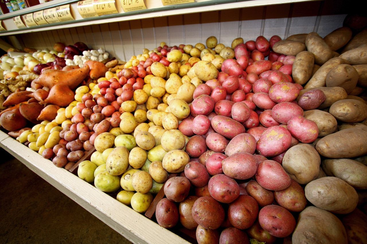 Abundance Close-up Color Food Food And Drink For Sale Fresh Fresh Produce Grocery Store Healthy Eating Indoors  Large Group Of Objects Market Market Stall No People Organic Potato Potatoes Produce Product Photography Red Potatoes Retail  Variation Vegetables White Potatoes