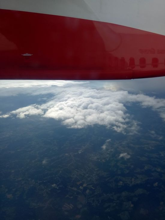 Aerial View Red Cloud - Sky Airplane Flying Outdoors No People Day Transportation Nature Mid-air Air Vehicle Sky Scenics Plane Aerospace Industry Commercial Airplane Planet Earth