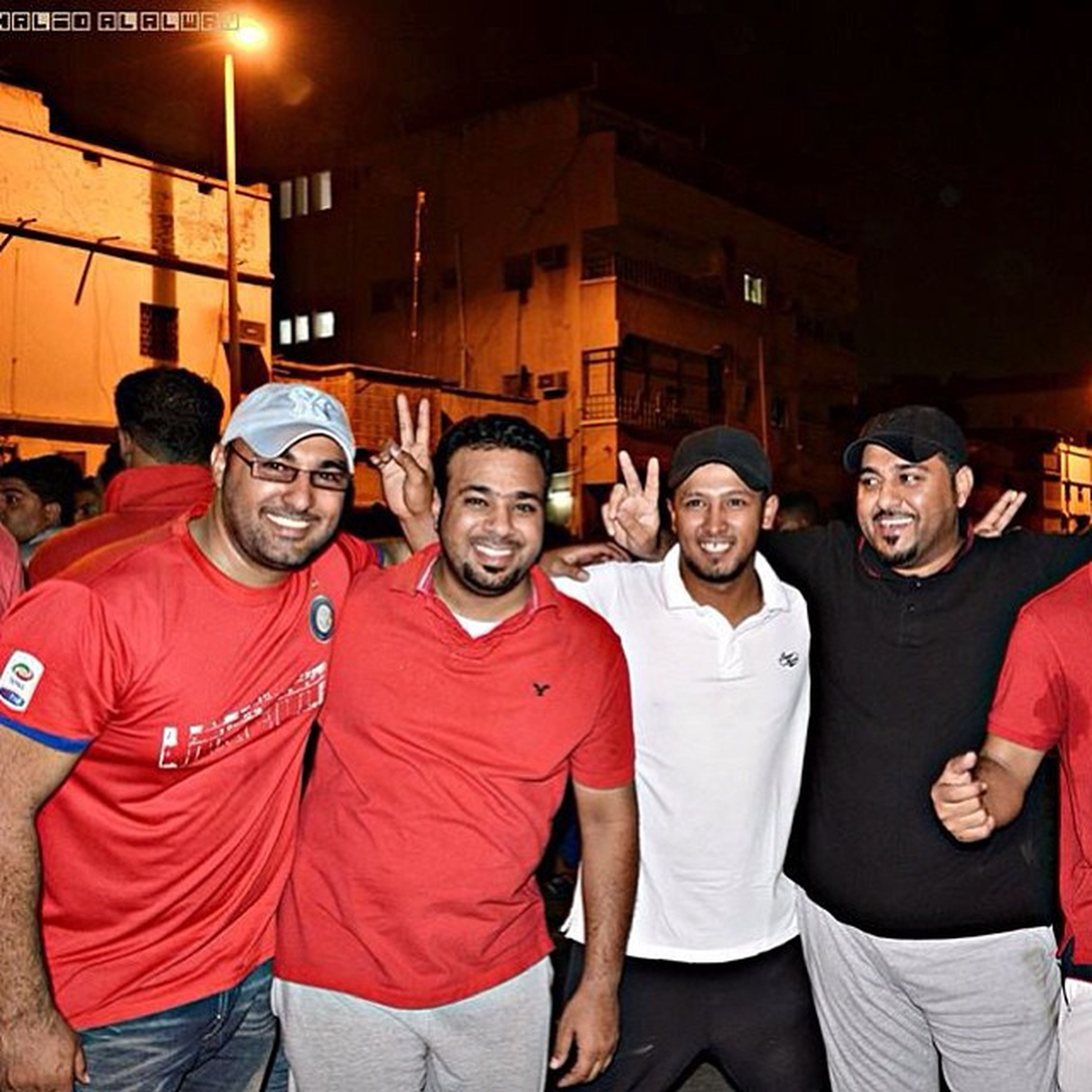 lifestyles, casual clothing, leisure activity, standing, togetherness, illuminated, night, front view, portrait, men, looking at camera, three quarter length, waist up, young men, person, young adult, friendship