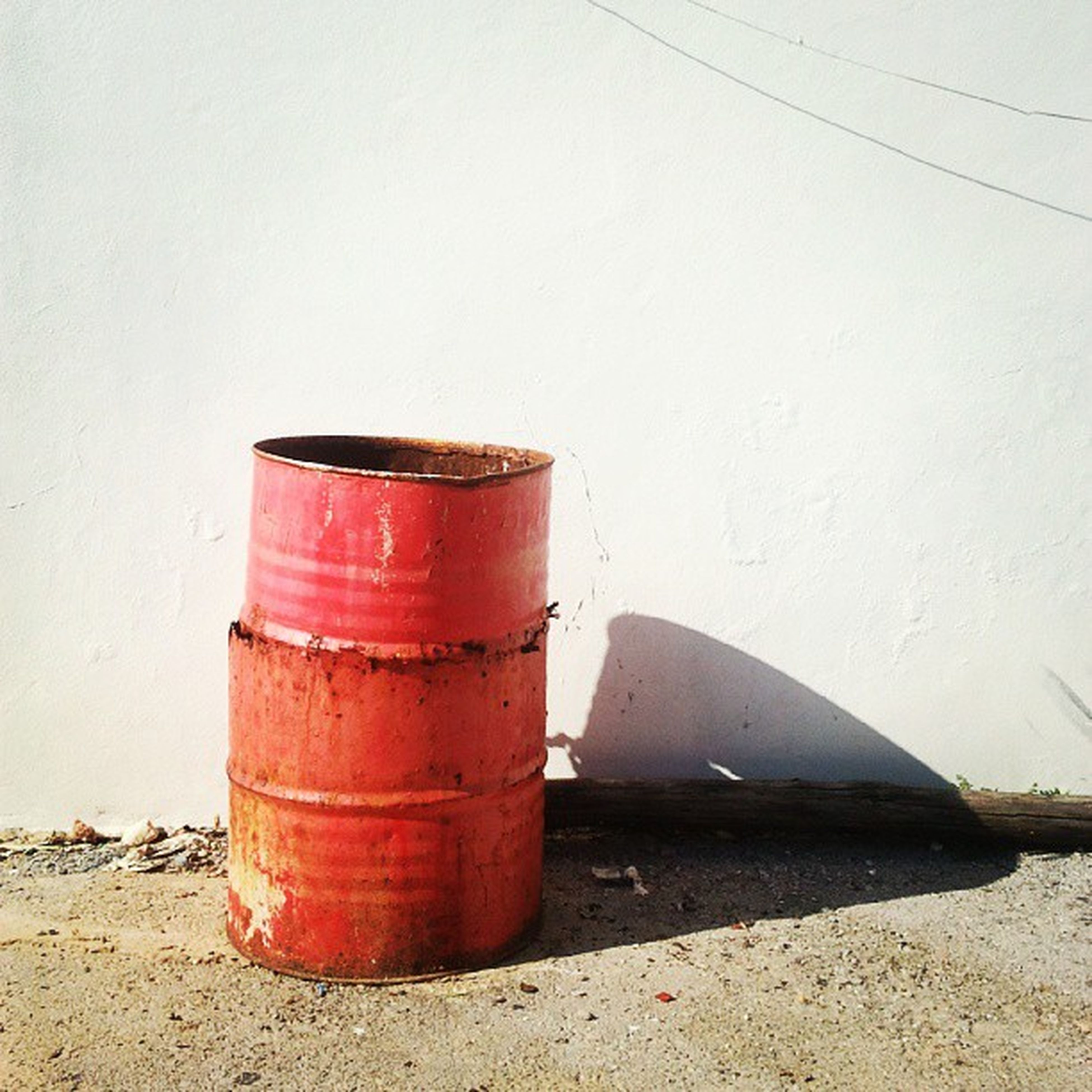 red, close-up, wall - building feature, container, still life, rusty, metal, no people, outdoors, day, built structure, old, single object, wall, abandoned, sunlight, metallic, building exterior, weathered, architecture