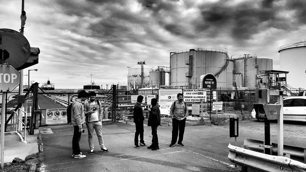 Men Cloud - Sky Real People Sky Outdoors Only Men City Adult Adults Only Large Group Of People People Day Refinery Black And White Photography Monochrome Photography Monochrome Blackandwhite Photography Street Photography Dark Clouds