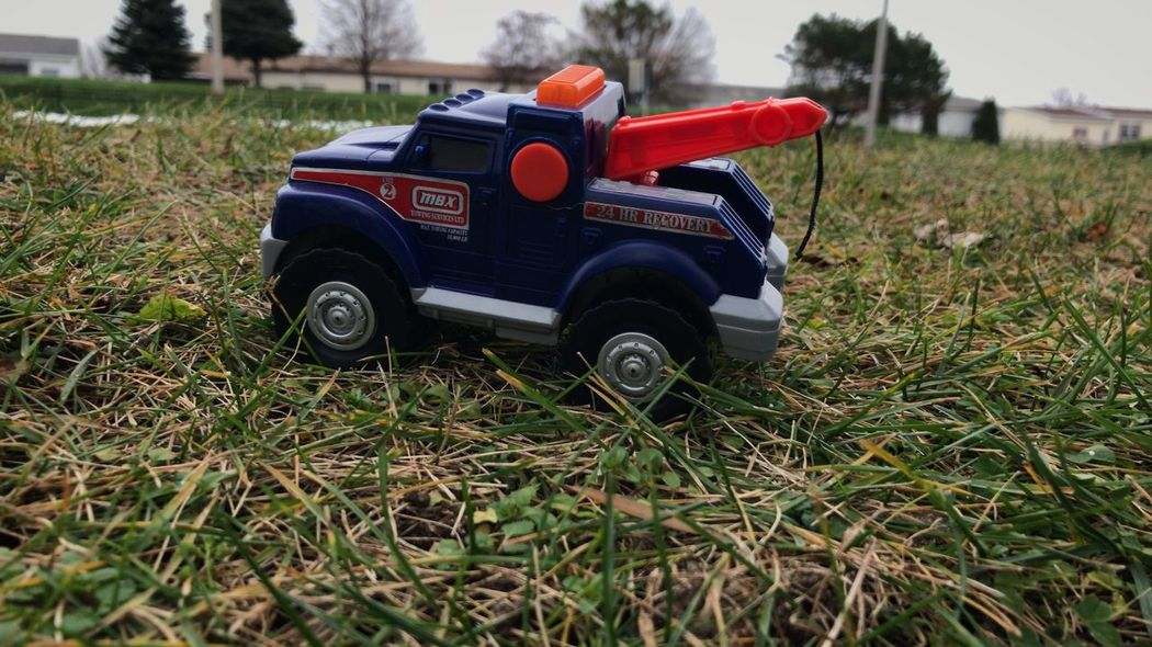 Found this toy truck lying around outside. Red Day Grass No People Outdoors Nature Taking Photos Iphoneonly Close-up Toys Toytruck Things I See Toy Truck
