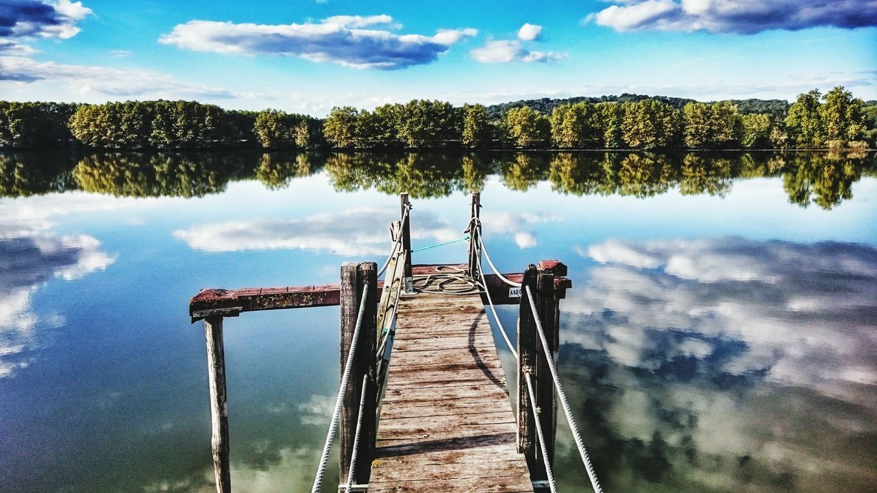 Urt TakeoverContrast Water Pier Lake Reflection Sky Tranquility Wood - Material Cloud Tree Tranquil Scene Scenics The Way Forward Nature Cloud - Sky Calm Standing Water Beauty In Nature Day No People Vscocam Capture The Moment Weekend Activities Dramatic Sky Outdoors