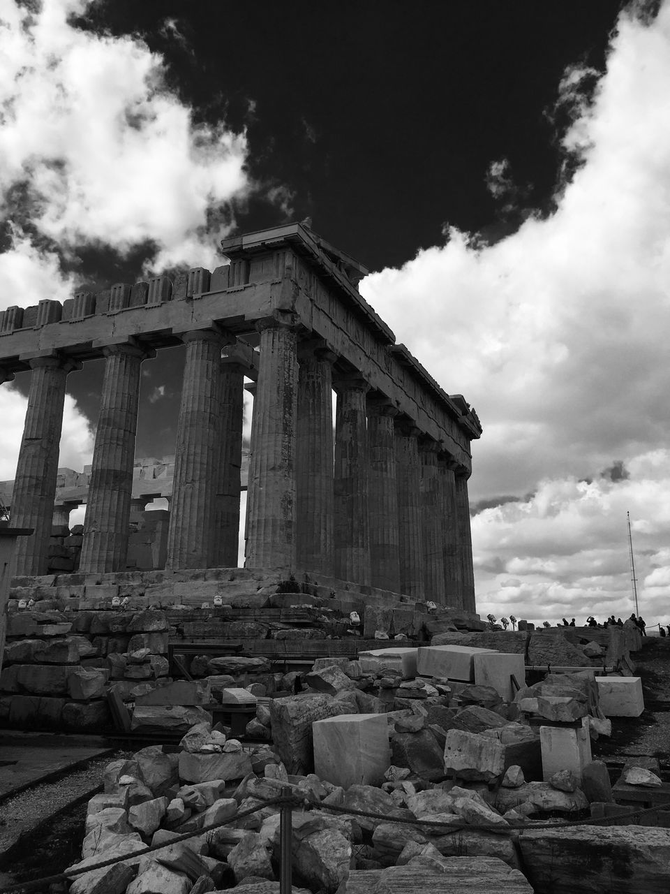 Acropolis Of Athens Against Cloudy Sky