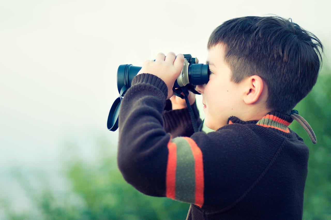 Close-Up Of Boy Using Binoculars