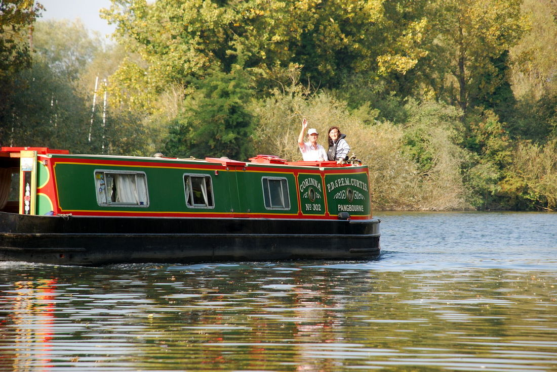 BargeOnTheRiver Adult Canals And Waterways Day Leisure Activity Men Mode Of Transport Nature Nautical Vessel Outdoors People Real People River Togetherness Transportation Tree Water Women
