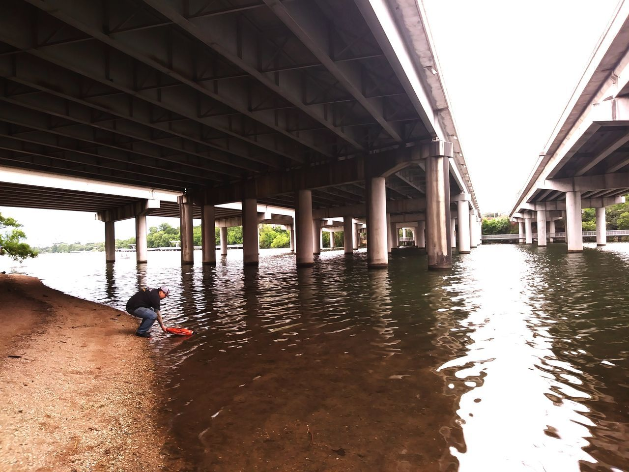 The Street Photographer - 2017 EyeEm Awards Austin,tx Built Structure One Person Architecture Festival Beach Ladybird Lake Rc Boat A Man And His Toys Hobbies RC Underpass Under A Bridge