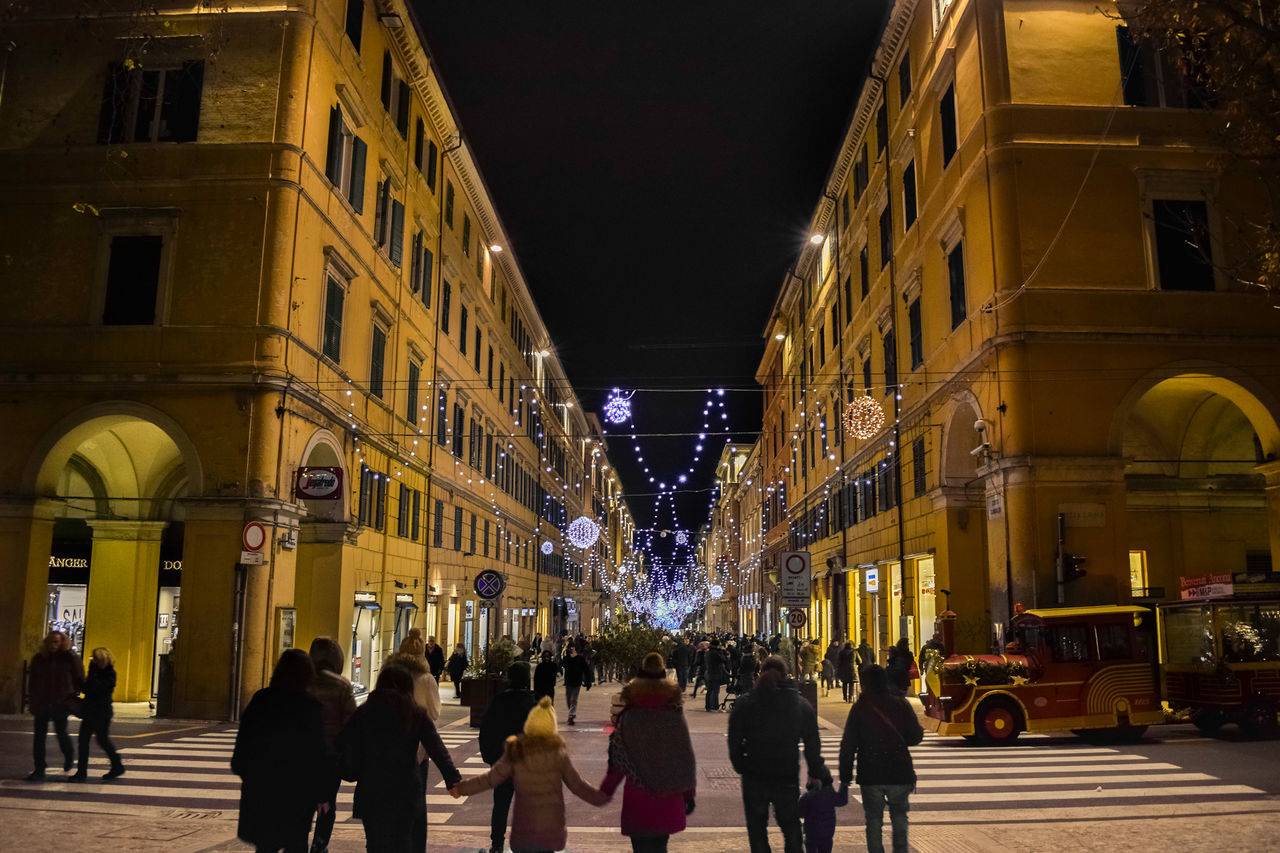 Adult Adults Only Architecture Building Exterior Built Structure Christmas City Family Group Of People Illuminated Large Group Of People Men Night Night Lights Night Photography Nightphotography Nikond3300 Outdoors People Sky Street Photography Streetphotography Travel Travel Destinations Walking Around