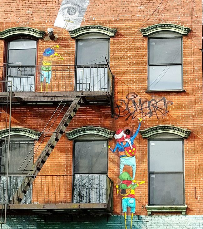 Sneaky lil devils! Dope work by Osgemeos twins. Check This Out Februaryphotochallenge Showcase: February February 2016 Shootermag My City Fire Escape NYC Street Photography Street Photography City Life NYC Photography Urban Urban Lifestyle Urban Landscape Walking Around EyeEm Best Shots EyeEm EyeEm Gallery Eye4photography  Eyemphotography Streetart/graffiti Streetart Graffiti Graffiti Wall Graffiti Art
