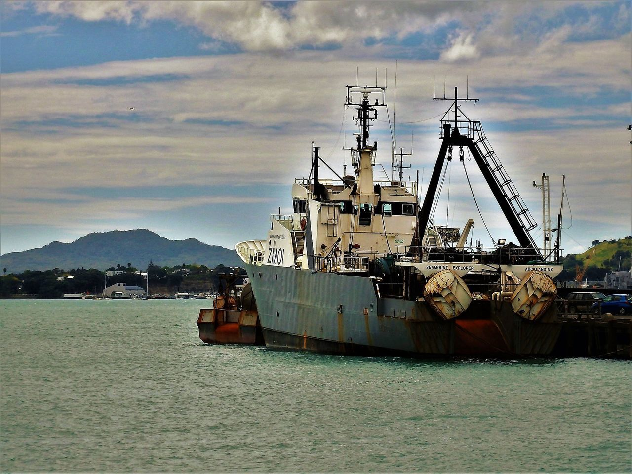 nautical vessel, transportation, water, mode of transport, sky, cloud - sky, mountain, ship, sea, moored, outdoors, waterfront, no people, freight transportation, day, nature, sailing, harbor, military, beauty in nature, oil pump