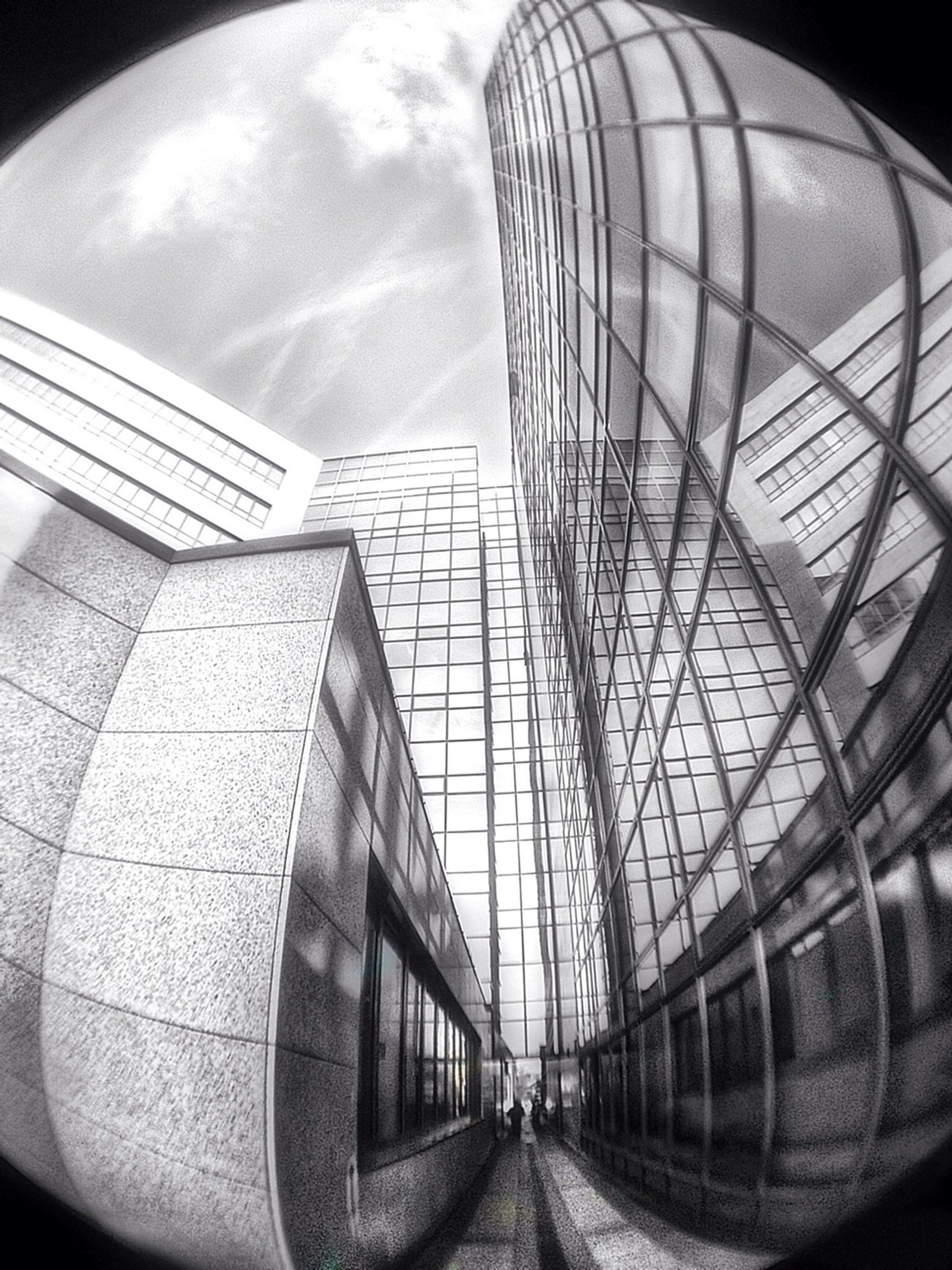 architecture, built structure, building exterior, modern, the way forward, diminishing perspective, transportation, sky, low angle view, glass - material, building, city, indoors, vanishing point, day, no people, pattern, reflection, office building
