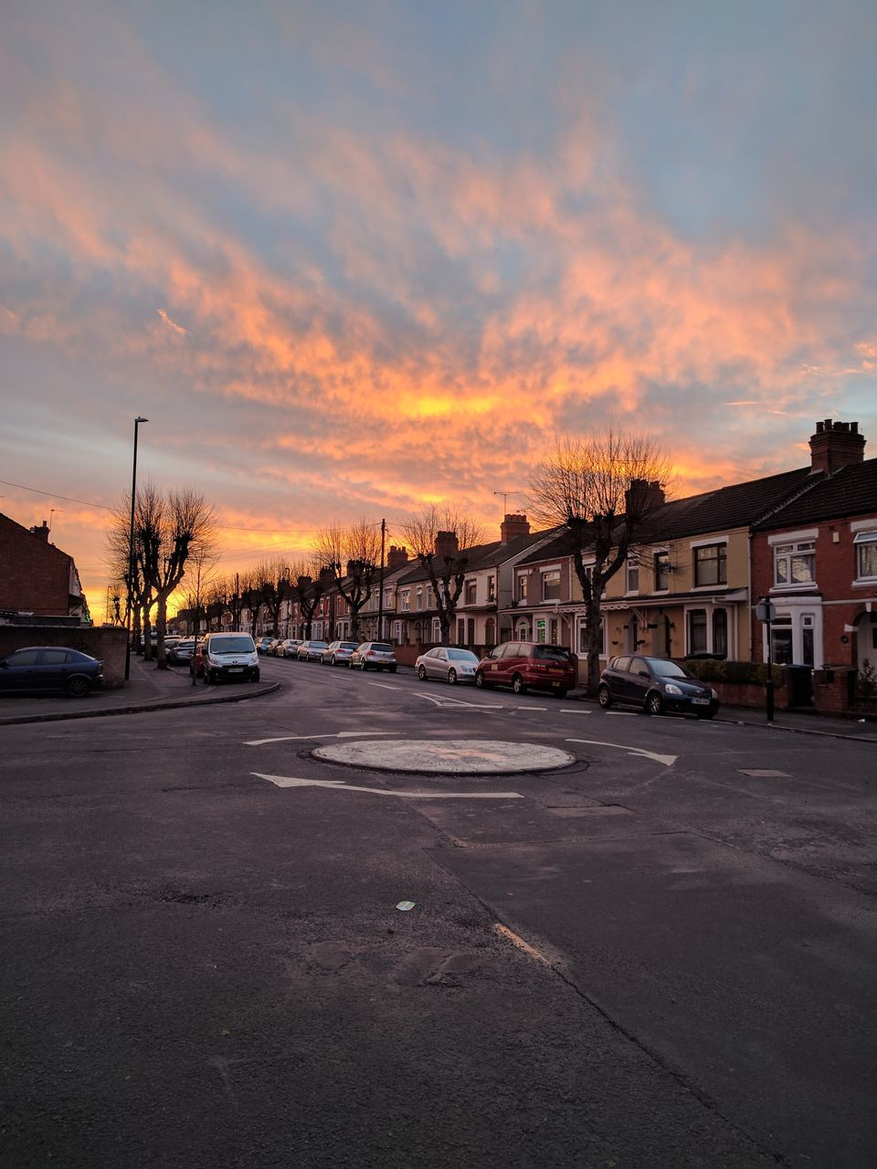 Road In City Against Sky At Sunset