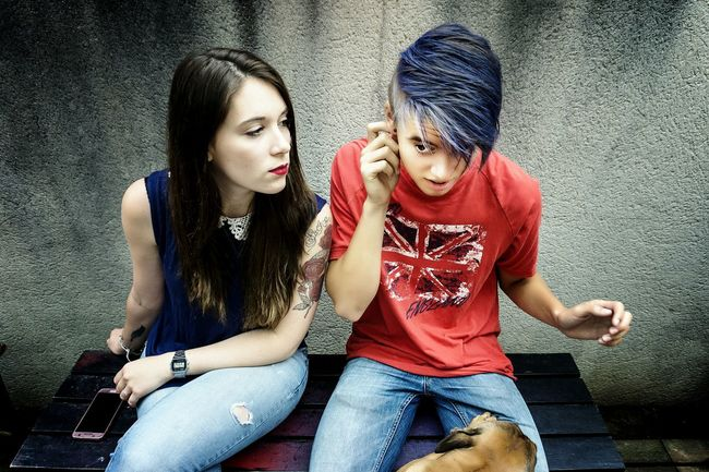 Brother and sister. Young And Beautiful Togetherness Lifestyles Leisure Activity Young Women Sitting Three Quarter Length Portrait Person Young Adult Looking At Camera Casual Clothing Friendship Long Hair Blue Hair Color Hairstyle Headshot Human Hair