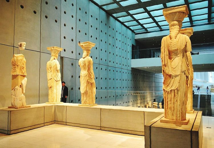 Caryatids at the Acropolis Museum. Athens, Greece. EyeEm Selects Indoors  Light Light And Shadow Caryatids Caryatid Architecture No People Athens, GreeceGreece Athensvoice Nikonphotography TheWeekOnEyeEM Travel Destinations Vacations City Citylife Statue Statues Museum AcropolisMuseum Paint The Town Yellow