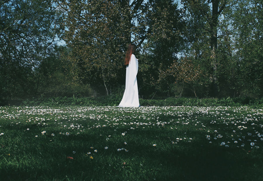 Alone Beautiful Everyday Joy EyeEmNewHere If Trees Could Speak Lost In The Landscape New Peace Beautiful Woman Beauty In Nature Branch Flower Forest Forest Trees Forestwalk Full Length Grass Growth Nature One Person Outside Photography Standing Tranquil Scene Tree White