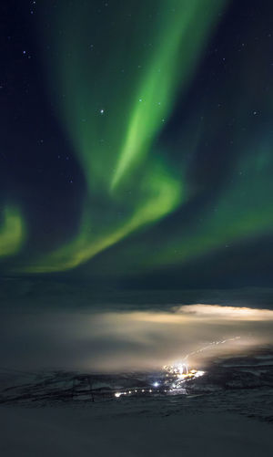 Astronomy Aurora Polaris Beauty In Nature City City Lights Cold Temperature Dramatic Sky Fog Foggy Green Color Green Color Ice Landscape Mountain Natural Phenomenon Nature Night No People Norhtern Lights Outdoors Sky Snow Space Sweden Winter