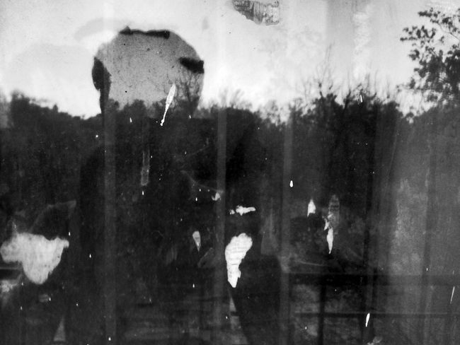 I am standing Aloneand clicking myself just Spending Time alone.Black And White Blackandwhite Self Portrait Reflection Silhouette Against Horizon Tree Lined Evening Light Play Dirty Window Watching Yourself Showing Imperfection Telling Stories Differently Shadow Past Regret