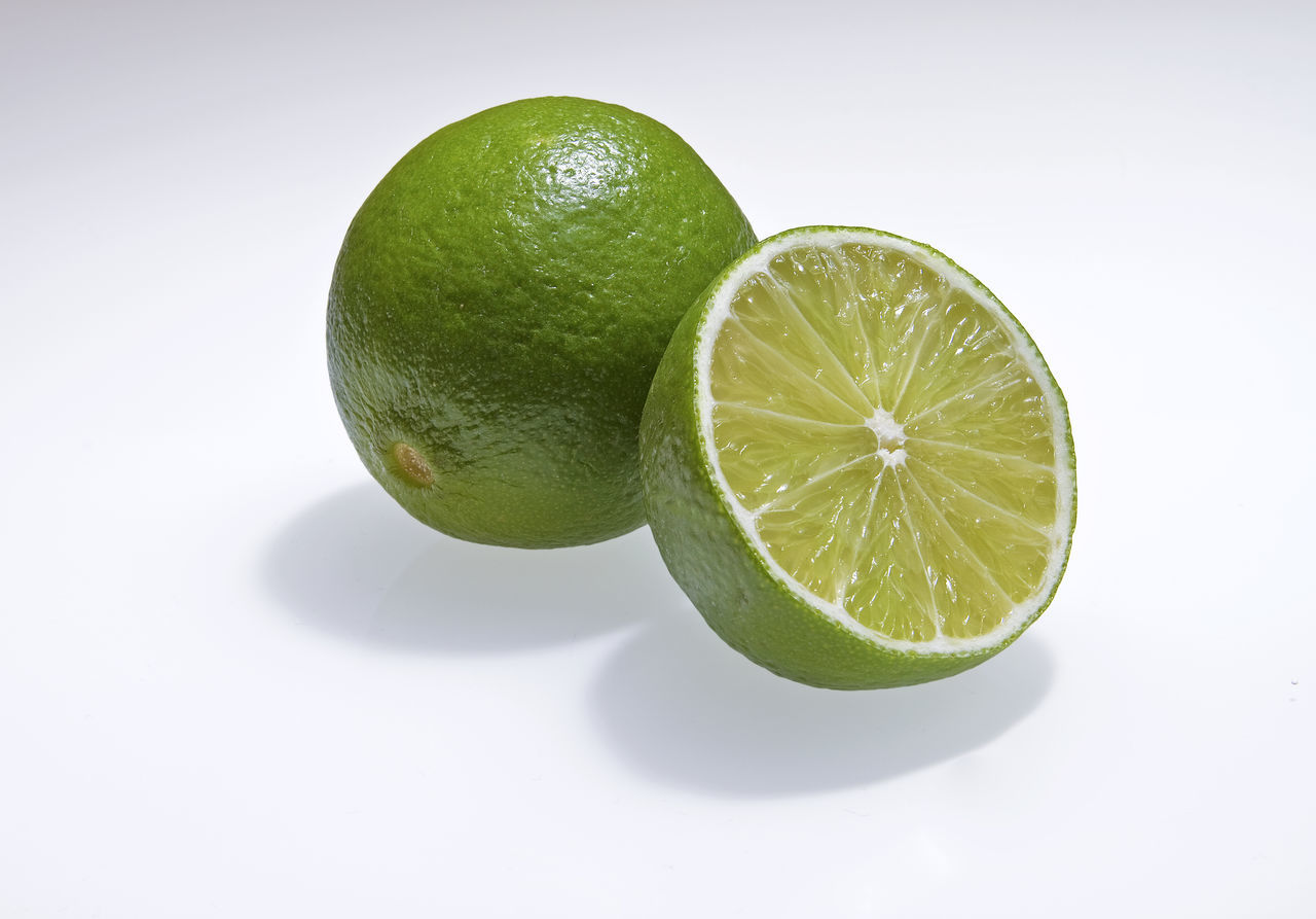 Citrus Fruit Close-up Day Dieting Food Food And Drink Freshness Fruit Green Color Healthy Eating Indoors  Lime Limette No People Nutritional Supplement SLICE Sour Taste Studio Shot White Background
