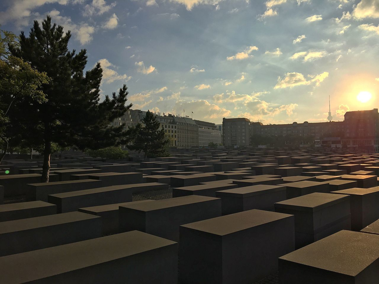 in a row, memorial, cemetery, no people, built structure, sky, outdoors, architecture, building exterior, sunset, day, tree