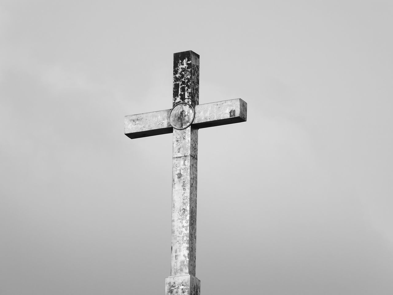 cross, low angle view, no people, religion, day, spirituality, outdoors, sky, clear sky, nature, close-up