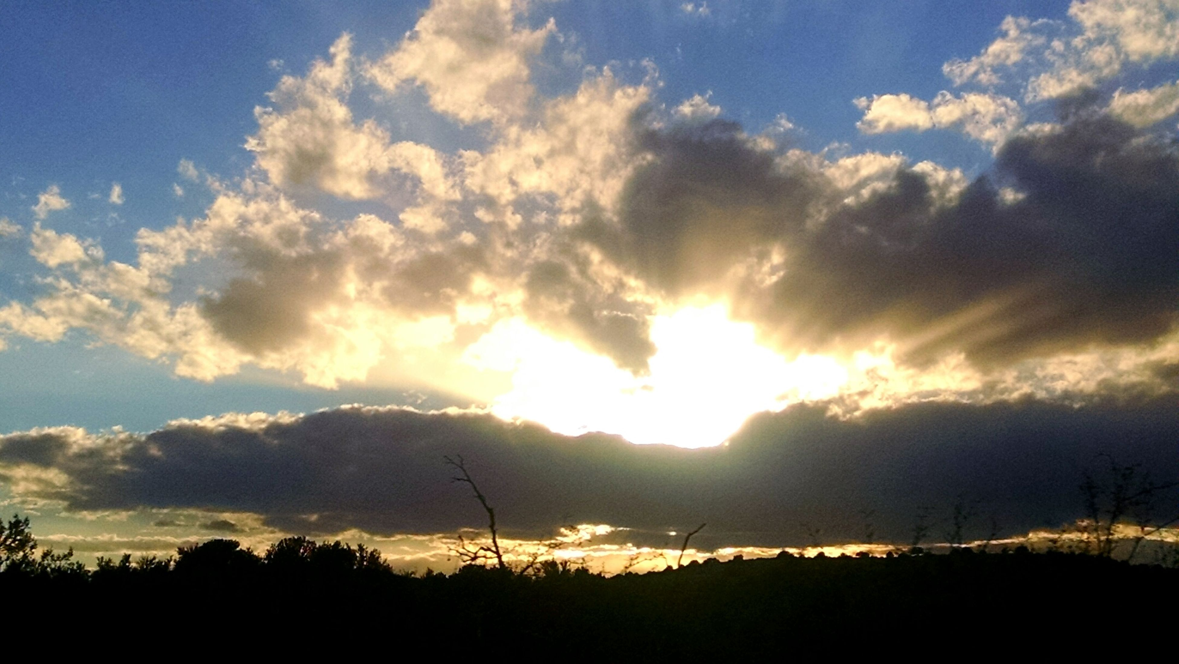 sky, silhouette, sunset, tranquility, tranquil scene, beauty in nature, scenics, cloud - sky, sun, nature, electricity pylon, power line, low angle view, landscape, cloud, electricity, sunlight, idyllic, tree, sunbeam