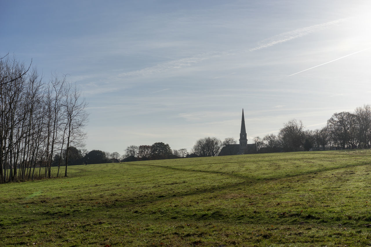 Architecture Church Church Tower Day Grass Landscape Nature No People Outdoors Park - Man Made Space Sky Steeple Tree