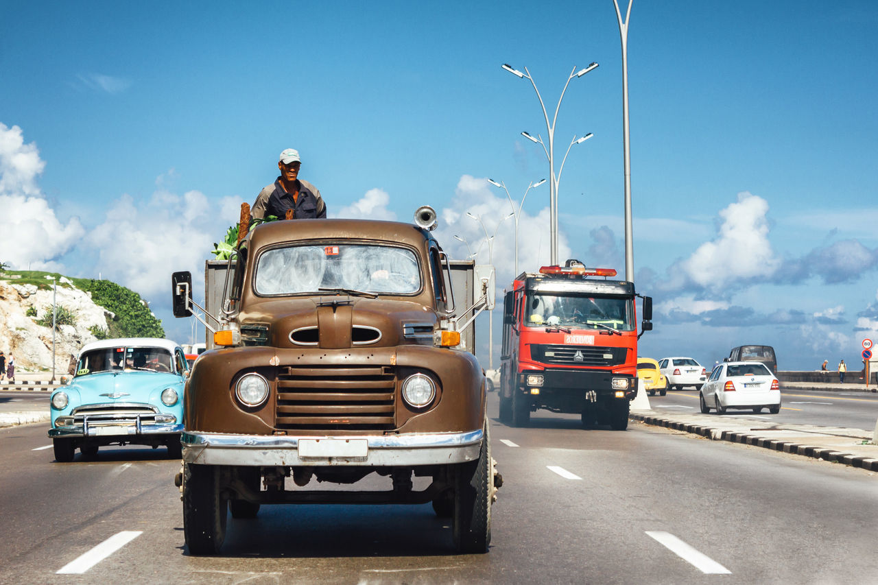 Classic Cars Cuba Collection Cuban Life Fireman From My Point Of View Getting Inspired Malecon Mode Of Transport Motion Old Car Outdoors Road Sky Streetphotography Transportation Truck