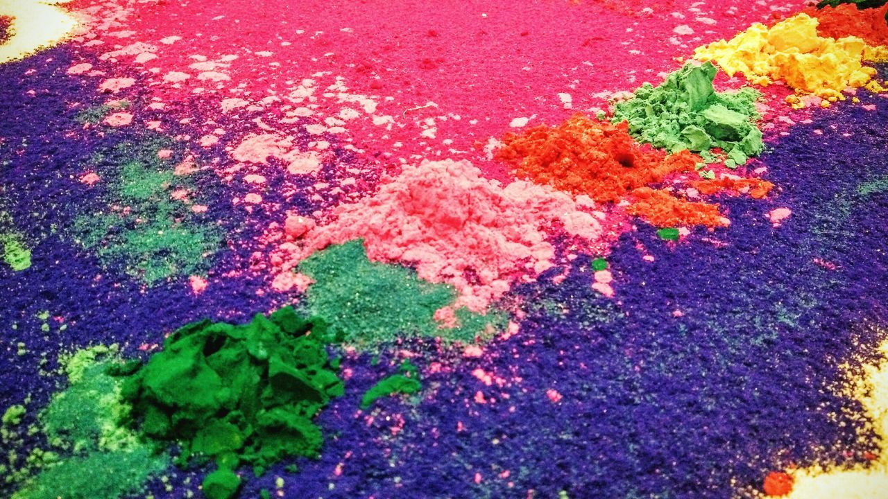 multi colored, high angle view, no people, powder paint, flower, day, green color, outdoors, close-up, nature, fragility, beauty in nature