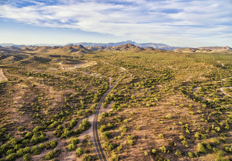 Apache Junction overview Apache Junction Arizona Cloud Cloud - Sky Countryside Day Green Color Growth High Angle View Idyllic Landscape Mountain Mountain Range Nature Outdoors Plant Remote Scenics Sky Solitude Tranquil Scene Tranquility Travel Destinations Tree