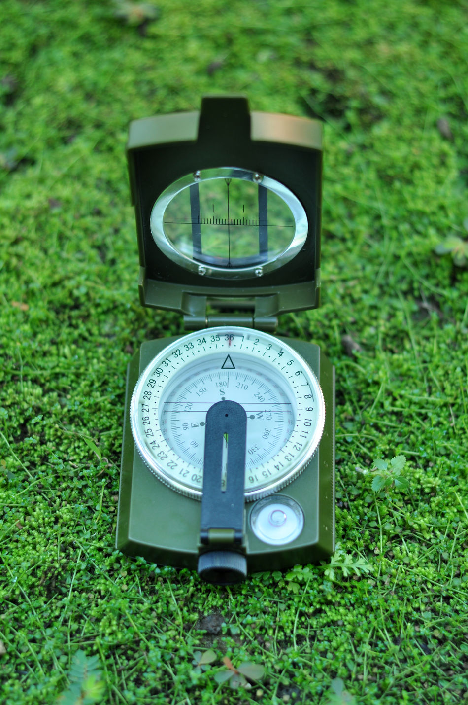 Outdoor Compass Close-up Day Direction Expedition Field Grass Green Color Hiking Instrument Of Measurement Journey Lost Meter - Instrument Of Measurement Nature Navigation Navigational Compass No People No People Outdoors North Number Outdoors Traveling Trekking