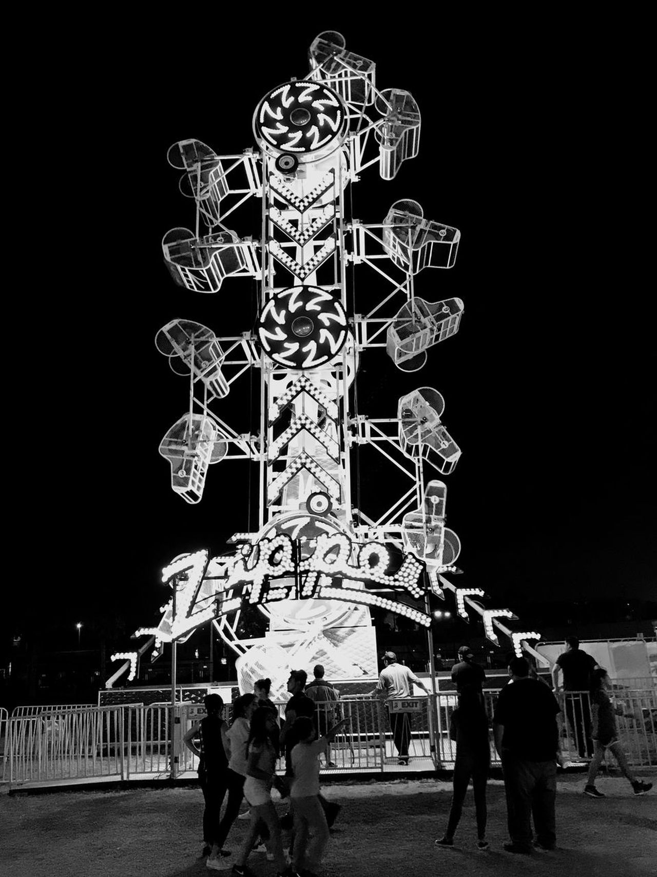 Black and white Night Real People Men Amusement Park Lifestyles Illuminated Women Large Group Of People Arts Culture And Entertainment Amusement Park Ride Carousel Outdoors People Sky
