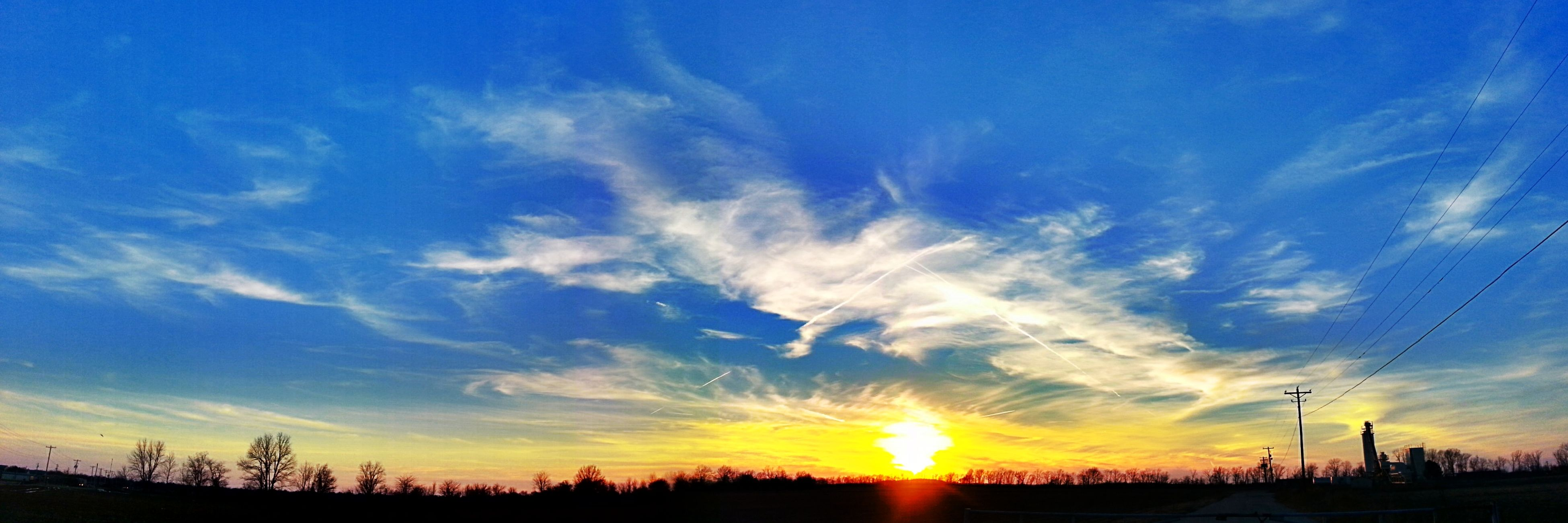 sunset, sun, silhouette, sky, scenics, beauty in nature, tranquil scene, tranquility, sunlight, sunbeam, orange color, nature, cloud - sky, idyllic, lens flare, landscape, cloud, back lit, blue, low angle view