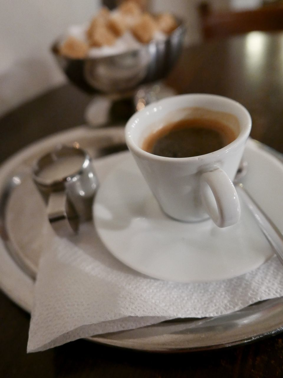 High Angle View Of Coffee With Sugar Served On Table
