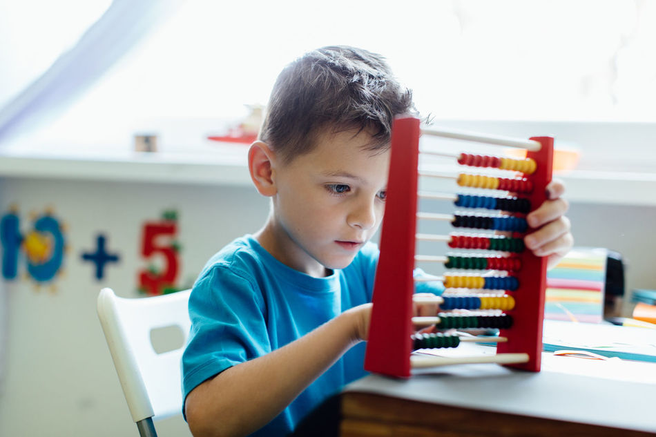 Schoolboy learning maths with an abacus at home Abacus Assignment Boy Caucasian Child Counting Critical Home Homeschooling Homework Independent  Kid Learn Learning Mathematics Maths Project Room School Schoolboy Schoolchild Solitary Student Thinking Young