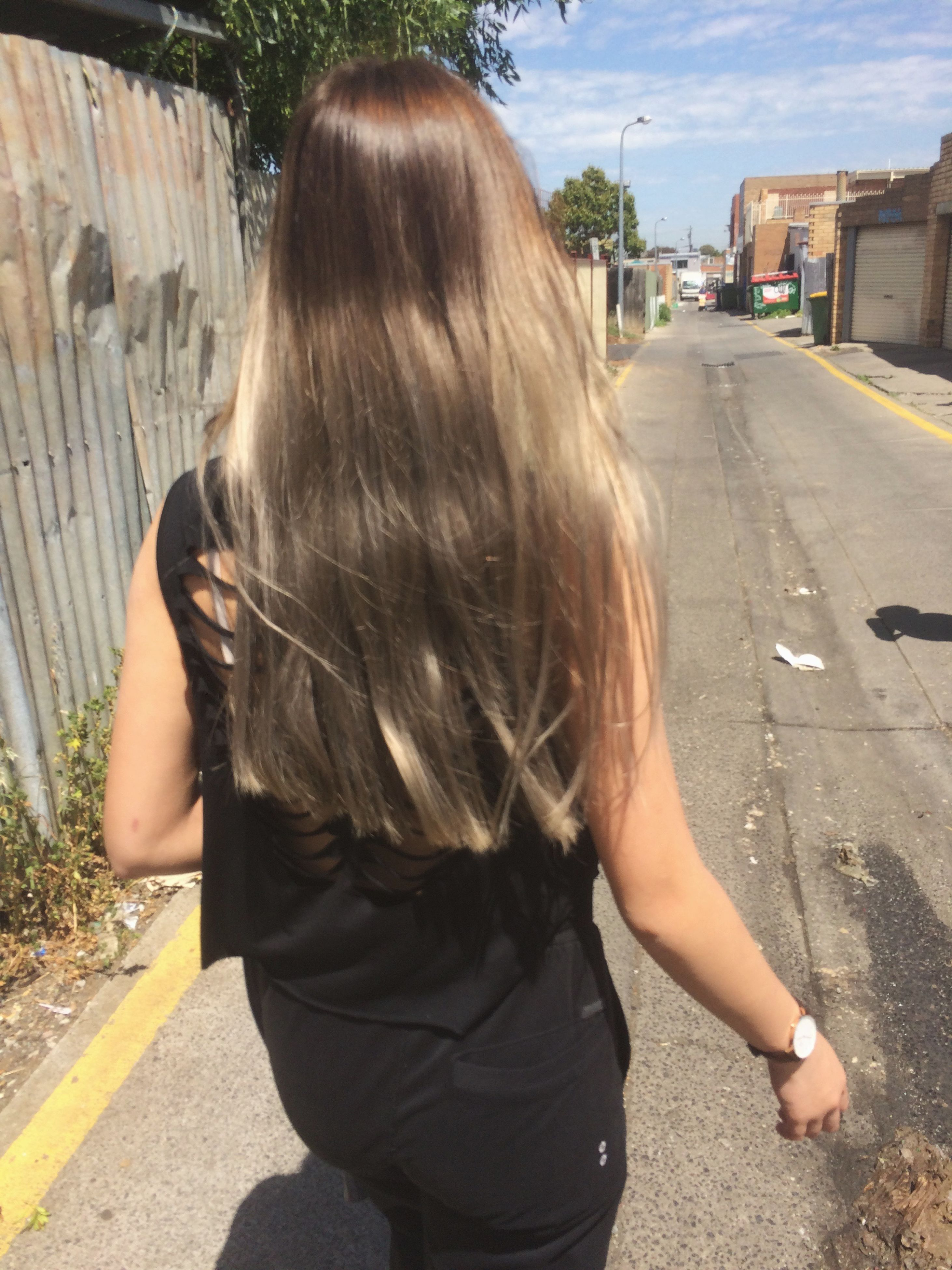 lifestyles, rear view, street, road, long hair, casual clothing, leisure activity, day, sunlight, blond hair, standing, brown hair, outdoors, building exterior, looking away, waist up, transportation, side view