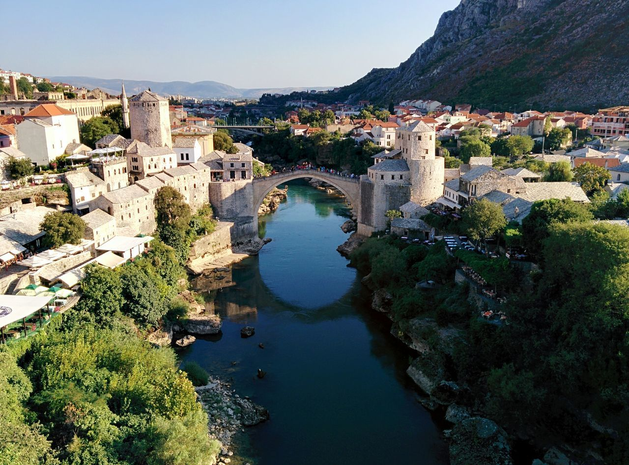 Stari Most Bridge Over River In Town By Mountains