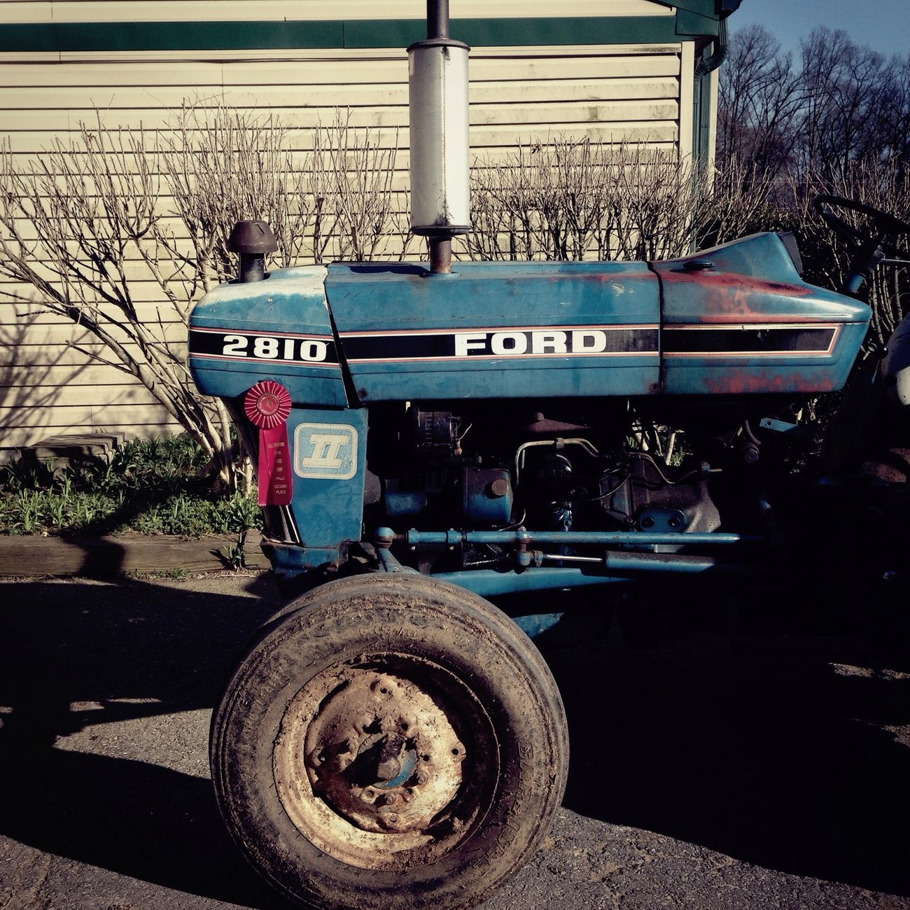 Urban 4 Filter in a non-urban setting At The Barn Tractor Red Ribbon Monday Mobilephotography