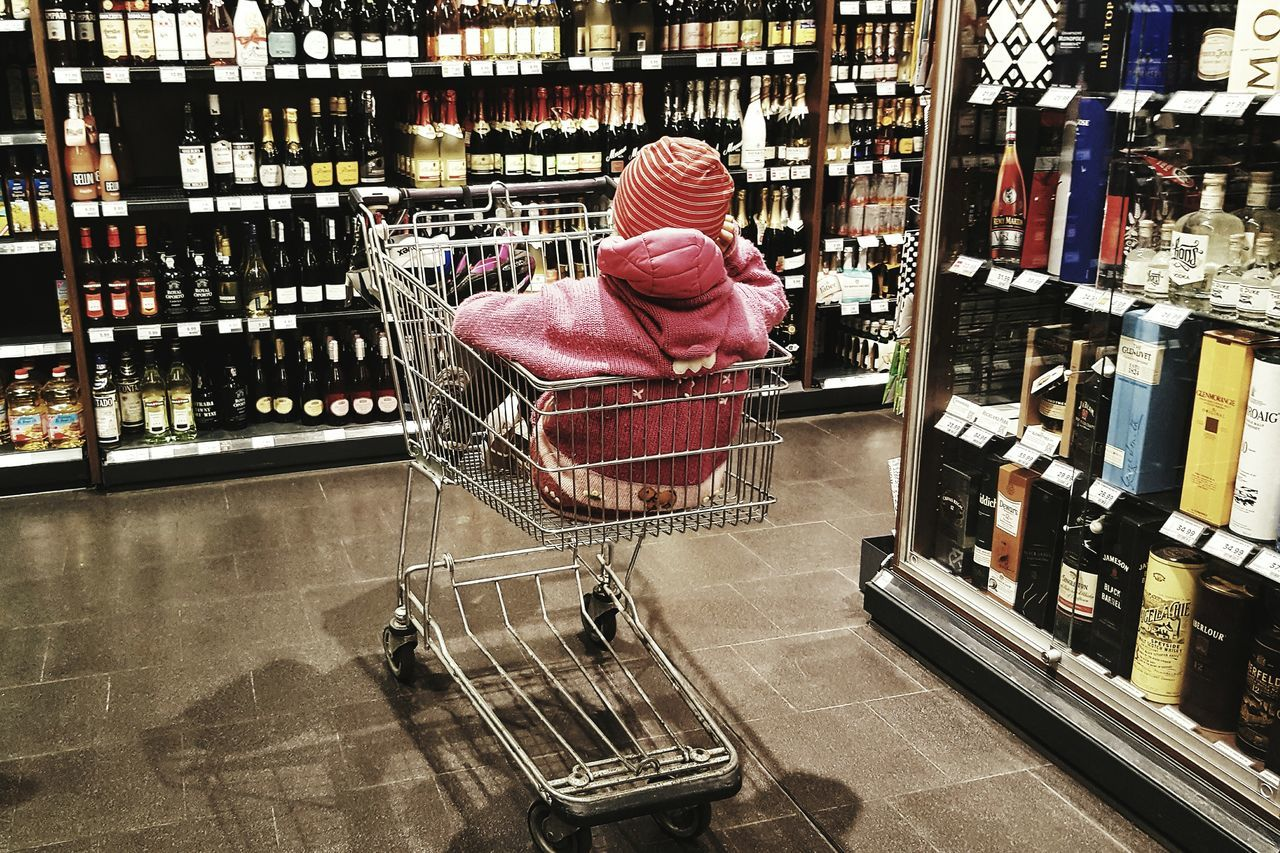 One Person People Real People Day Indoors  Supermarket Spirits One Child Only Shopping Cart EyeEmNewHere Social Issues Habits Responsible Drinking Controversial